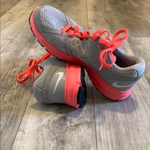 Gray and pink nike shoes